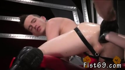 Anal fisting slave gay Axel s slot winks, signaling Bruce to dig in as well.