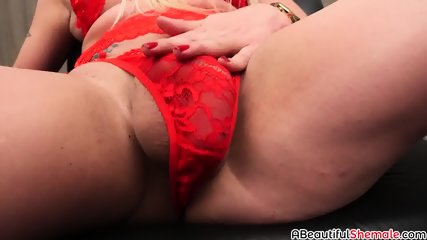 Blonde shemale Leticia Rodrigues masturbating all alone
