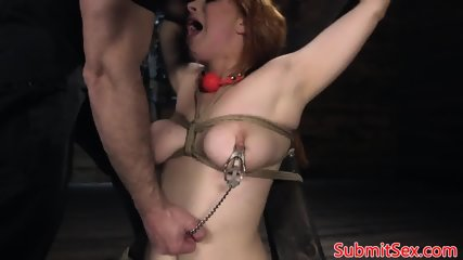 Restrained redhead assfucked by maledom