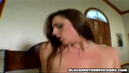 MILF fucks a black thug while someone is watching by the window