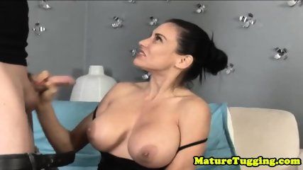 Busty MILF wanking dick and gets facialized