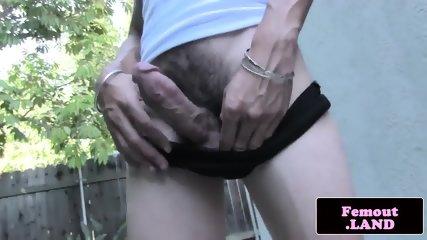 TS debutante masturbates outdoors in closeup