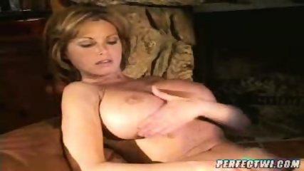 Busty lesbian MILFs play with dildo