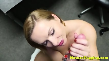 Office cougar tugging cock in POV
