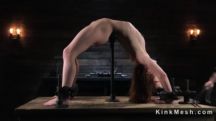 Extreme back arch bondage for redhead slave