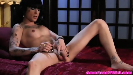 Inked trans babe jerking her dick and gaping