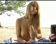 Sexiest blonde world wide gives a great handjob at the beach