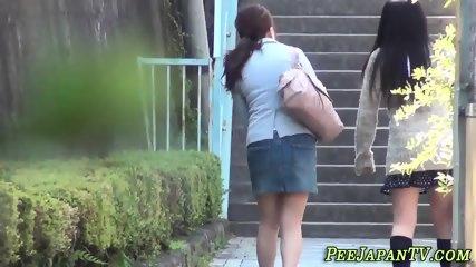 Asian ladies urinating