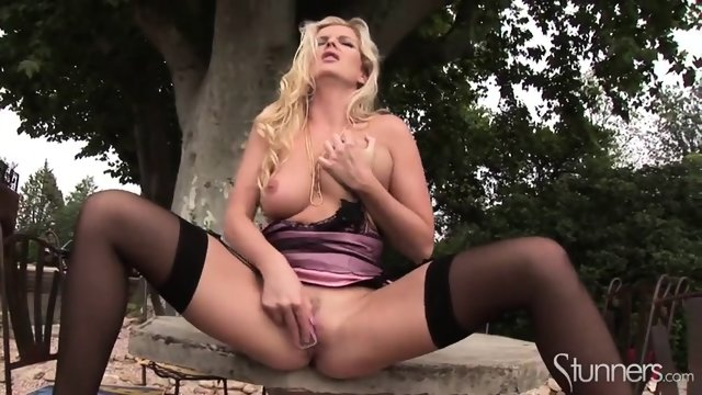 Stunning Blonde With Stockings Has Fun With Cell Phone