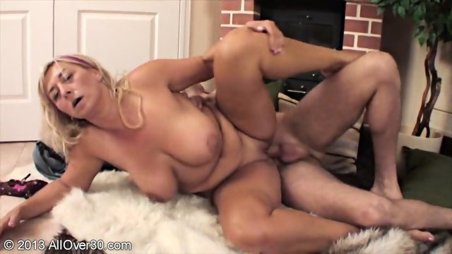 Busty Mommy Seduces Handsome Guy