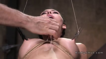 Busty slave gets threesome in dungeon
