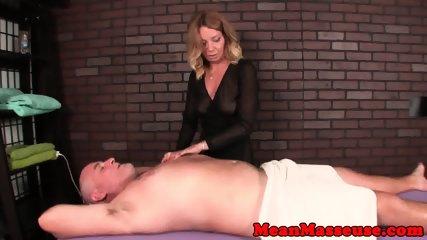Seductive mature masseuse ruins mans orgasm