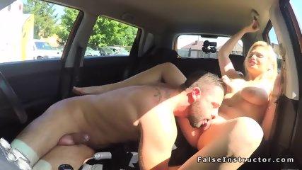 Big tits blonde driving examiner fucking - scene 6