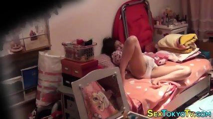 Japanese teen masturbates