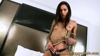 Slim black tranny jerking