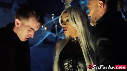 Beautiful and petite black demon fucked by two huge dicks