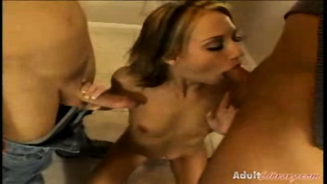 Sierra Sinn makes 2 cocks disappear in her mouth.