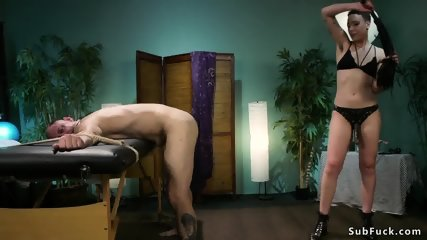 Masseuse ties up male slave and fucks him