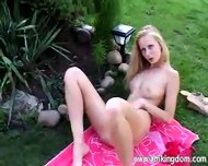 Blonde masturbating outdoors - scene 7