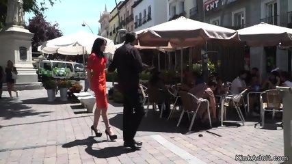 Gagged brunette tormented in public bar