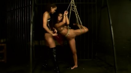 Tied girl gets spanked through her mistress