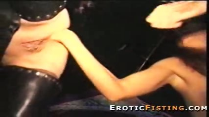 Pierced girl in leather gets her ass fisted by strangers - scene 8