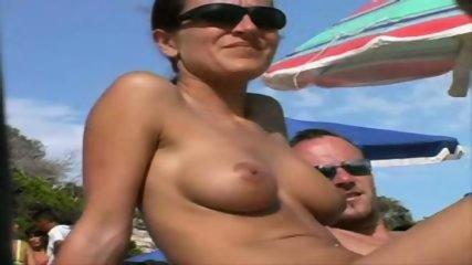 Voyeur cam at nudist beach - scene 2