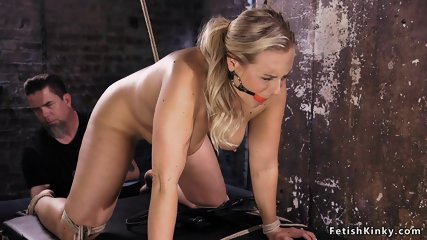 Gagged busty blonde whipped in bondage