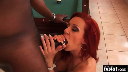 Redhead sweetie makes a black cock disappear