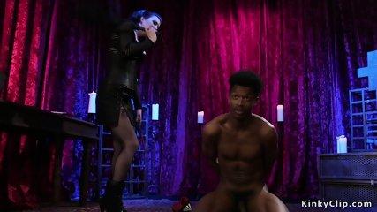 Hot dark haired mistress whips black sub