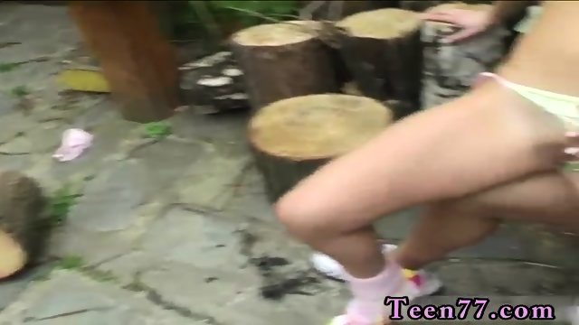 Petite mixed teen Cutting wood and slurping pussy