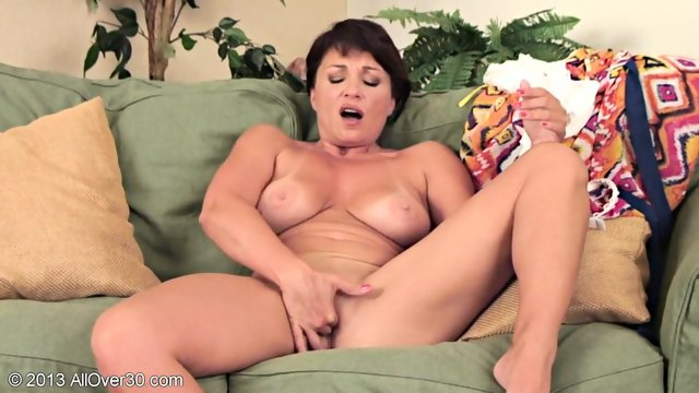 Lonely Mature Woman On Sofa