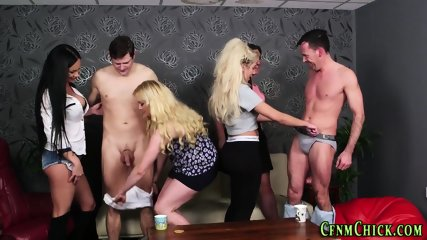 Clothed dominas in group
