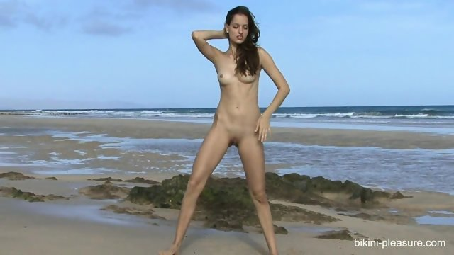 Naked Girl On The Beach