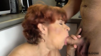 Horny mature bimbo with red hair and saggy tits