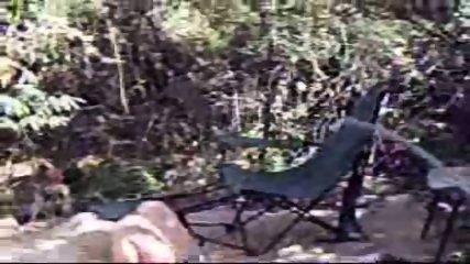 Chick caught masturbating on campsite - scene 8