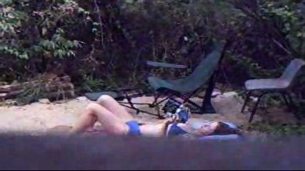 Chick caught masturbating on campsite - scene 1