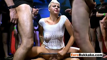 Short haired beauty gets pissed and drilled hard by group of men
