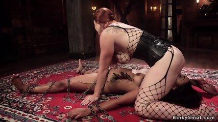 Redhead lesbian anal fucks ebony