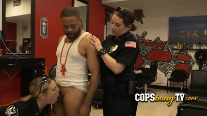 Busty cops catch criminal suspect as he is getting a haircut