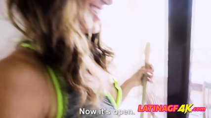 Latina chick sets the mood by lighting up some candles for her man