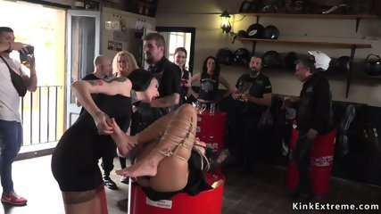 Tied up slave in biker shop fucked