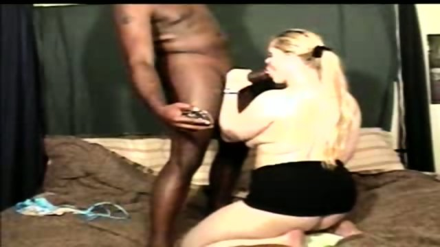 This whore sucks a big black dick