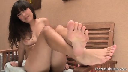 Barefoot brunette jumps on dildo 6