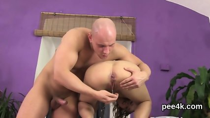 Charming idol gets her narrow twat complete of warm piss and squirts