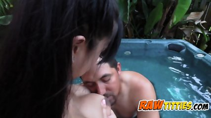 Asian busty chick plays around with her titties by the pool