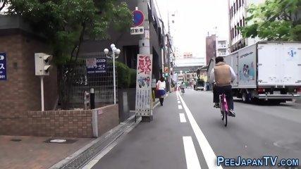 Japanese ho pisses street