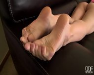 Blonde With Nice Feet On Black Leather Sofa