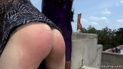 Brunette canes ass to blonde outdoor