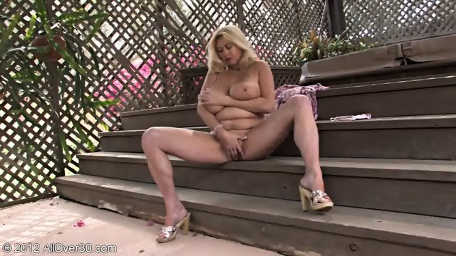 Mature Blonde Plays With Herself